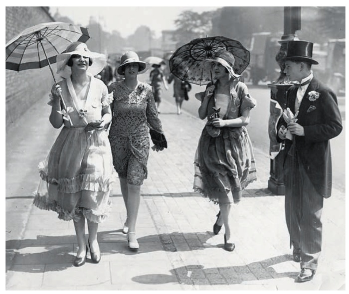 women beauty women in dresses walking with parasoles and hats on a street