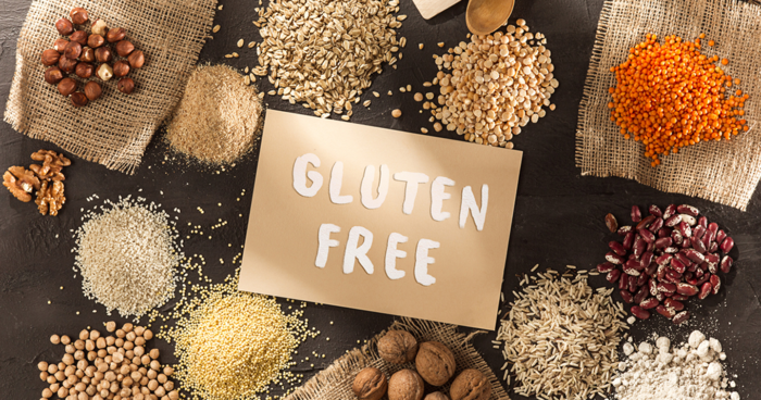 gluten free sign surrounded by rice beans wheat lentils and nuts