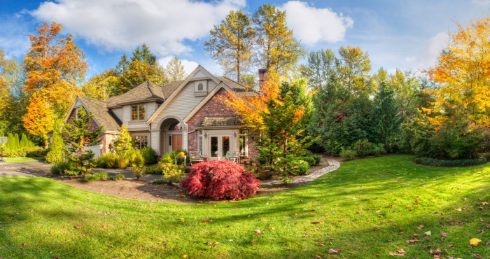 Panorama of suburban home on a sunny autumn afternoon