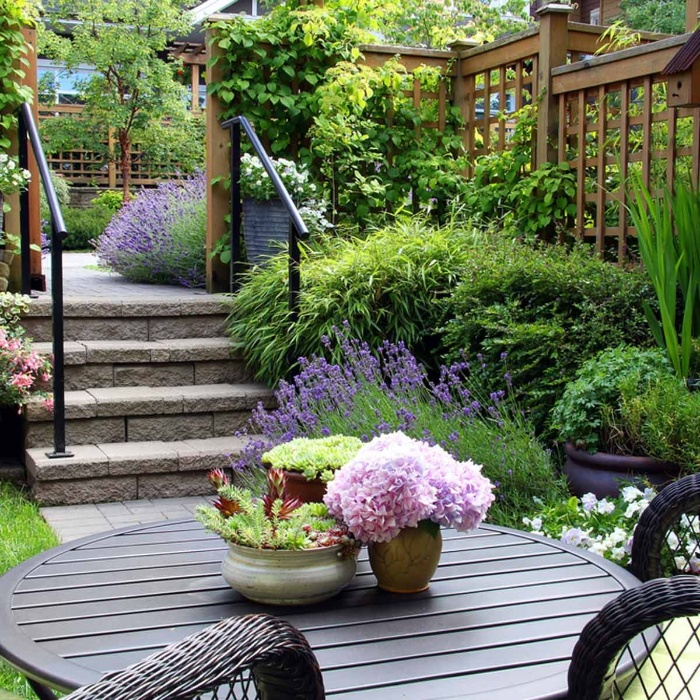 backyard garden with flowers rattan chairs lavender bushes