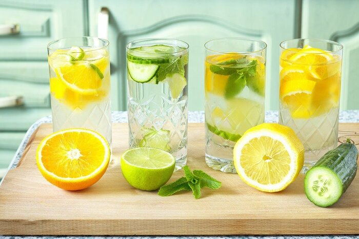 best hydration glasses of water with pieces of lemon lime mint and cucumber