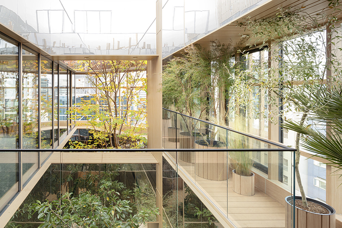 biophilic design glass building interior with living plants inside