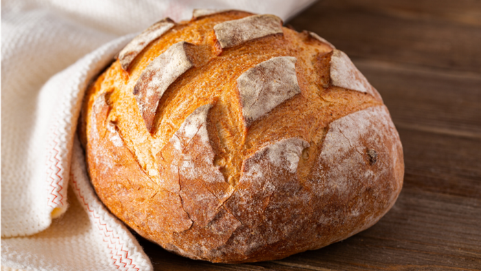 homemade fresh bread on a table covered with a white cloth