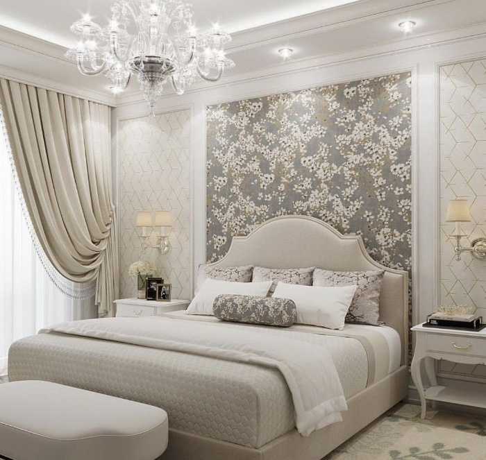 beautiful chandelier in a romantic bedroom with floral wallpaper
