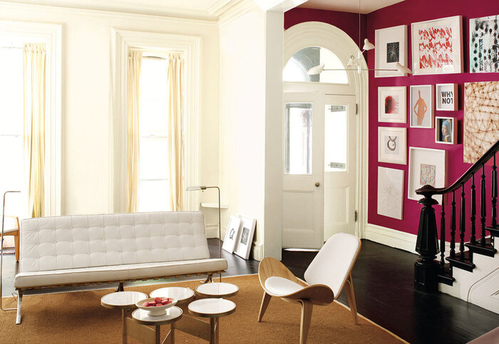 color choices in the interior white space with a bright lilac wall with art modern furniture