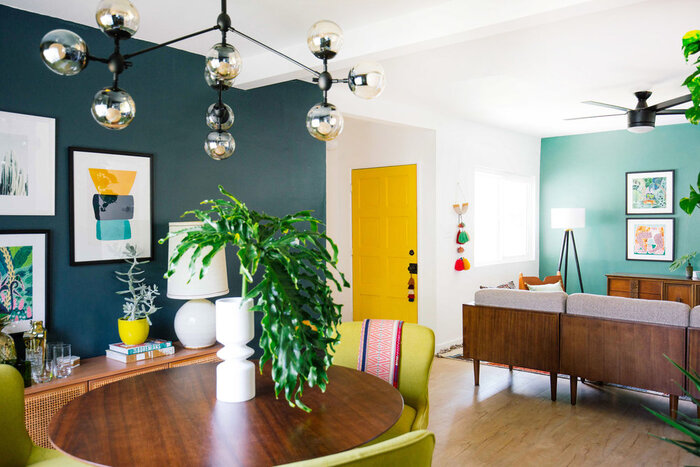 decorative journey in the interior with colorful walls dark and bright accents yellow door modern light fixture