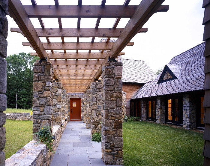 covered walkway with stone columns and wooden beams