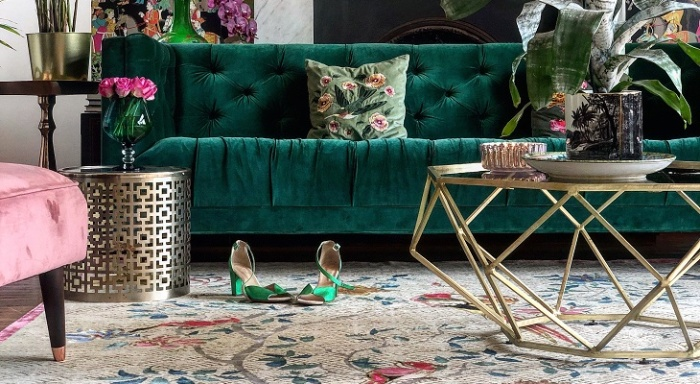 decorative interior in golden and dark green with floral statement pieces