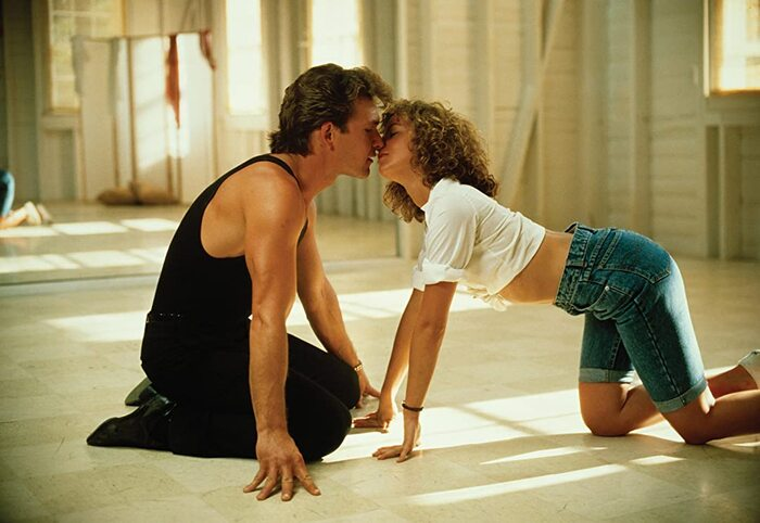 dirty dancing movie couple on the dance floor kneeling and kissing