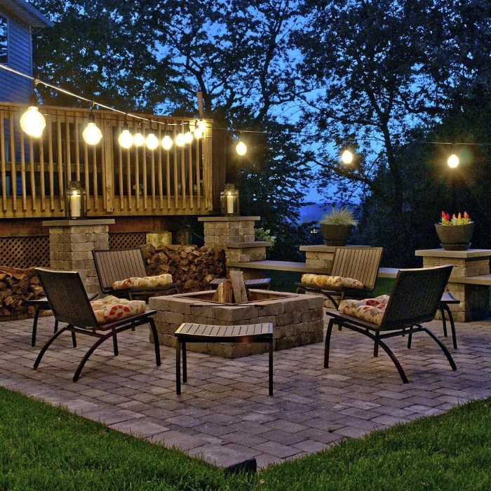 eye catching lamps bulbs on a porch with four chairs around a fire pit