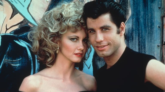 grease movie leading actors close up photo