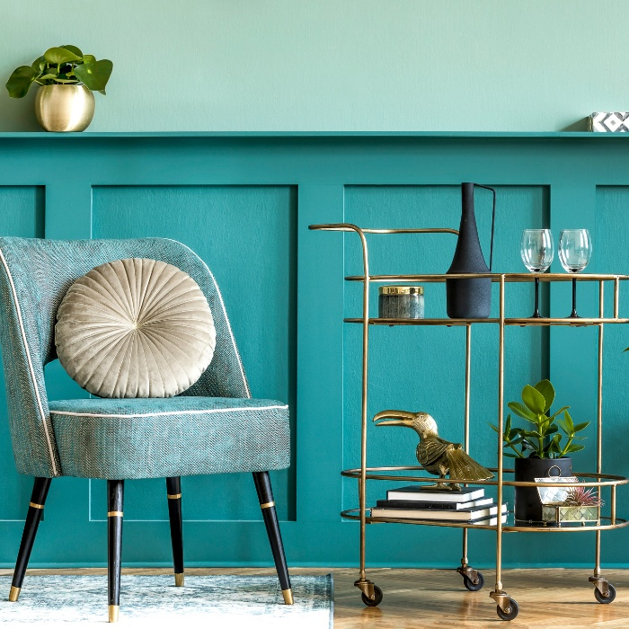 home decor in turquoise color chair and a golden serving stand