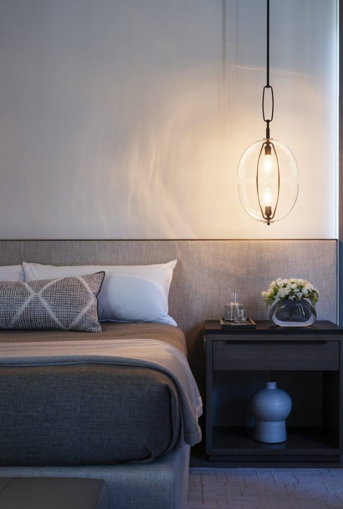 modern light over a night stand in a minimalist bedroom
