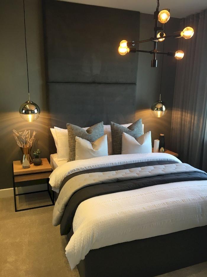 modern metal lights in a dark bedroom over the bed