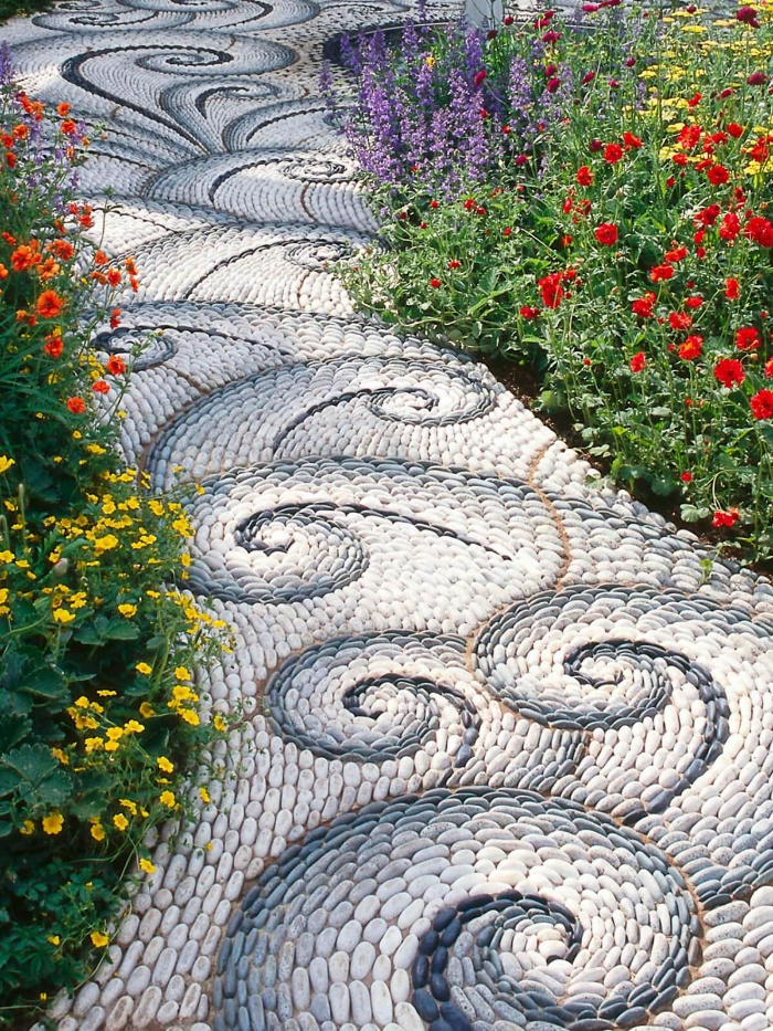 blue and white mosaic walkways wave pattern with flowers on the two sides