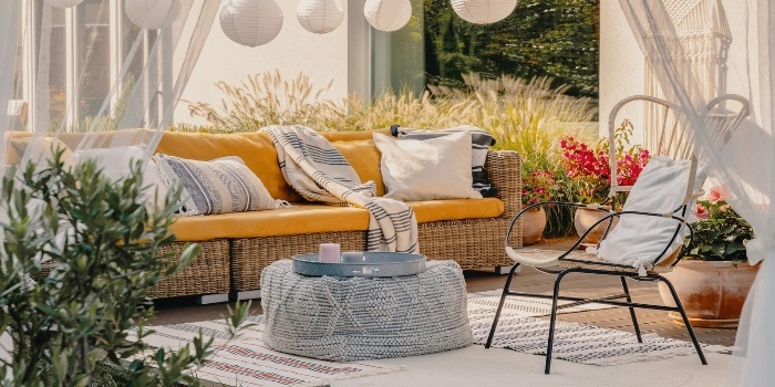 patio furniture woven furniture airy porch design in yellow and blue
