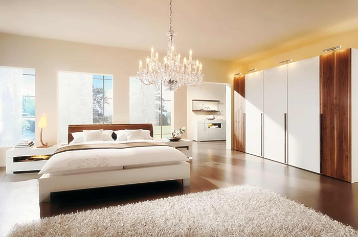 pendant light in a large light and spacious bedroom with a white carpet and large warderob