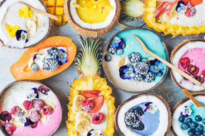 food trends rainbow food fruits filled with cream and flowers