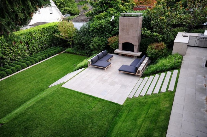 sloped yard with green grass and stairs