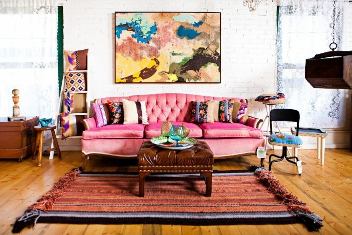 vintage boho interior in bright colors artwork pink couch and white wall