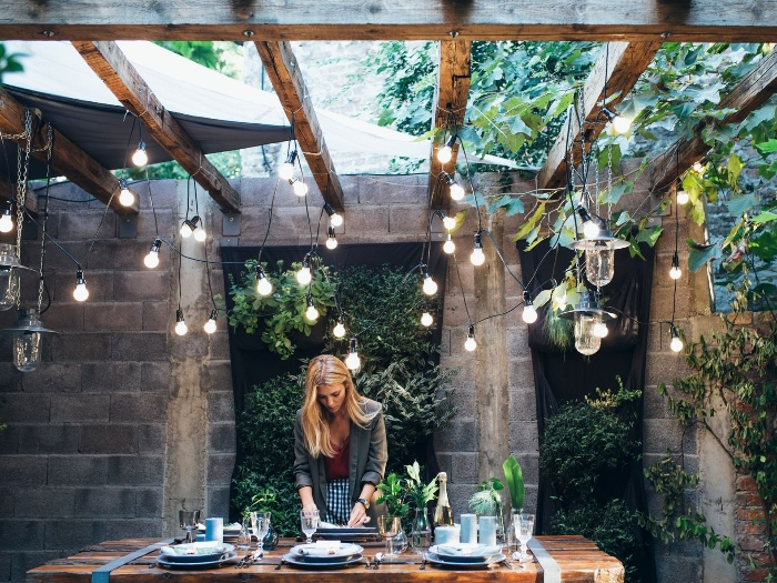 woman porch design outdoor space with hanging modern lights