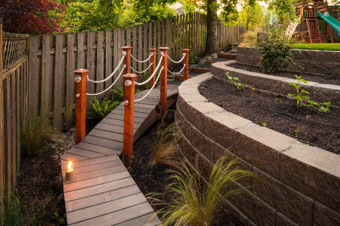 wooden design bridge pathway with stone walls and terraces