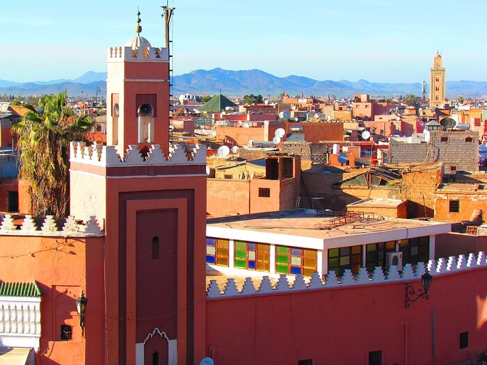 Marrakesh in Morocco red buildings traditional style with tall towers