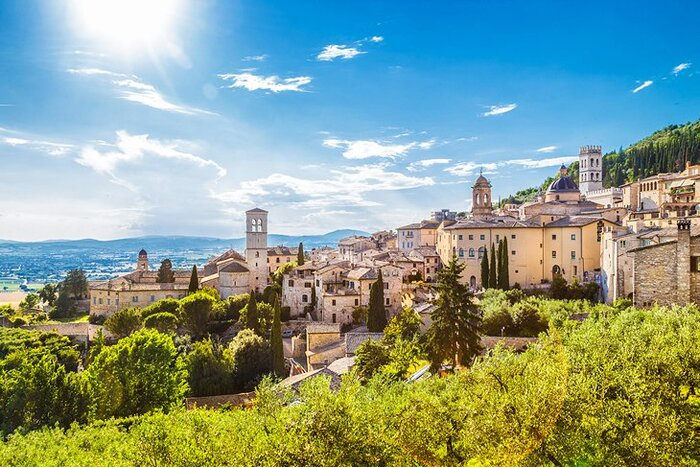 assisi italy view from the town with greenery high towers and buildings