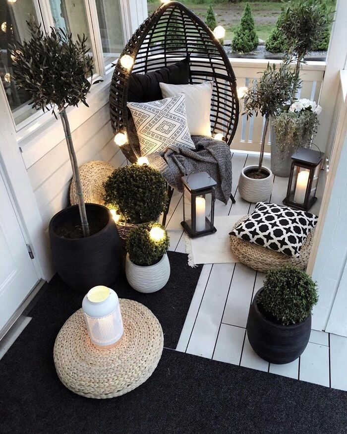balcony lights lanterns and outdoor lights white balcony with black furniture and decorative plants