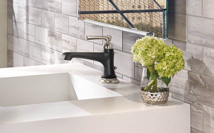 bathroom decor interior flower in a cup decoration white sink brick wall and a mirror
