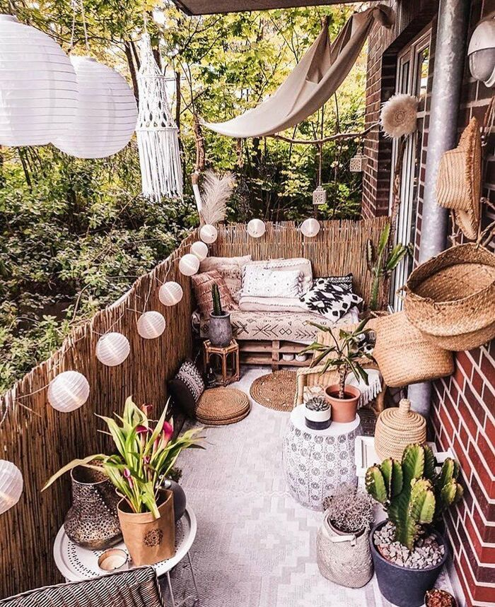 cute boho balcony with lanterns plants seating area and other accessories