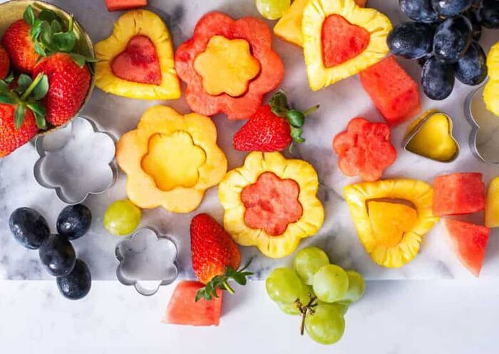 fruit cut outs flowers and hearts cut out of different fruits strawberries grapes watermelon