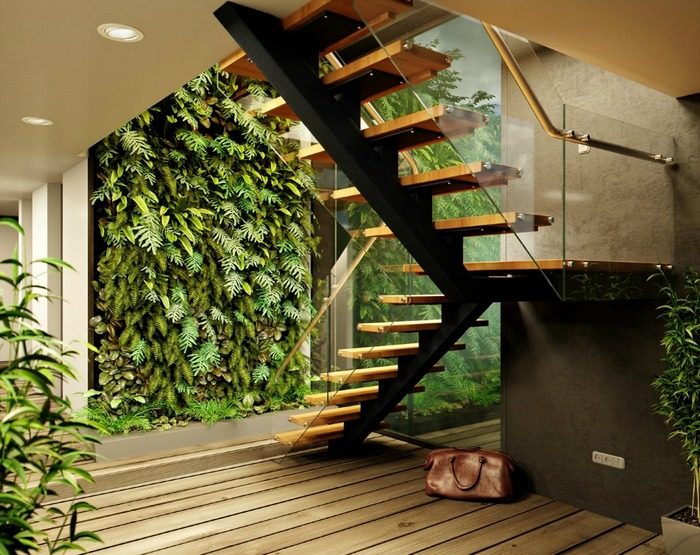 interior design trend modern interior with a green wall made of living plants and a wooden staircase