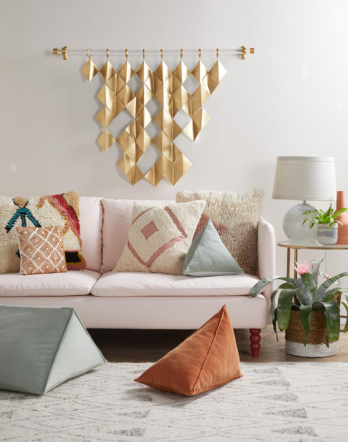 living room ideas cosy living room with a golden decorative wall piece decorative pillows and light creamy colors