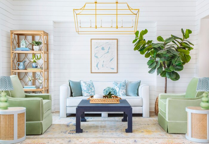summer home design trend with blue and green accents metal elements and living plant