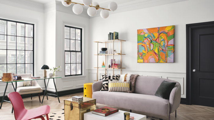 modern interior living room with colorful accents and artwork on the wall