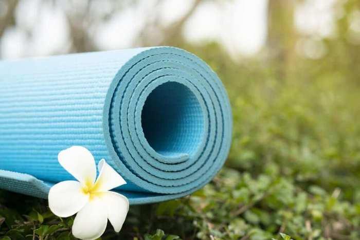 outdoor blue yoga mat with a white flower garden yoga spot