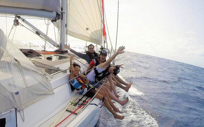 friends on a yacht enjoying the ride in the sea