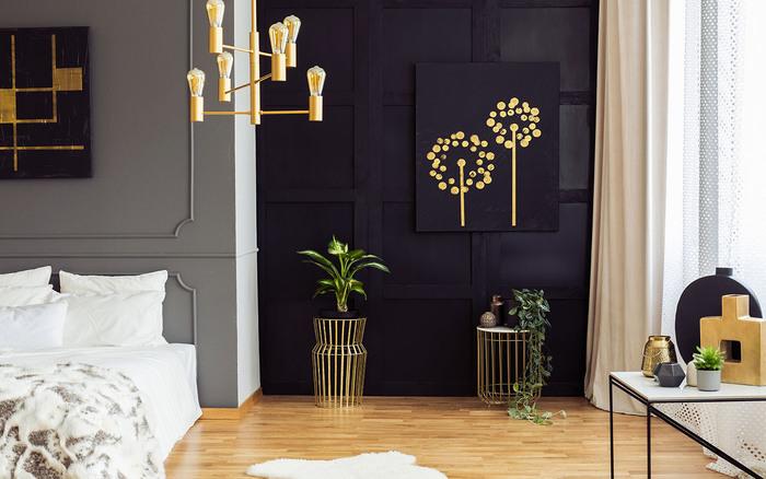 sleek dark bedroom interior with golden accents wall art and lighting fixtures