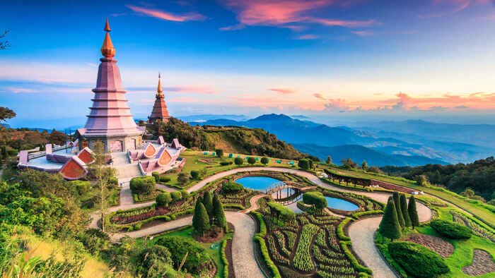 thailand landscape with temple towers overlooking a valley with beautiful gardens