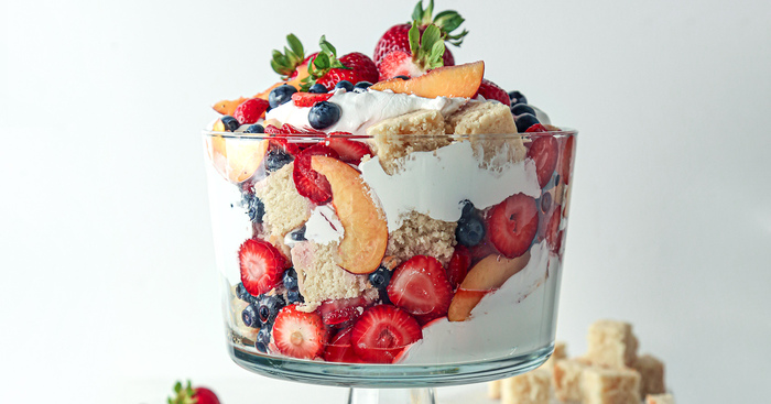 trifle fruit a large glass bowl with fruits cream and biscuits