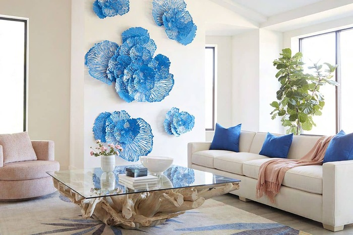 blue wall art white and blue living room with a wooden and glass table