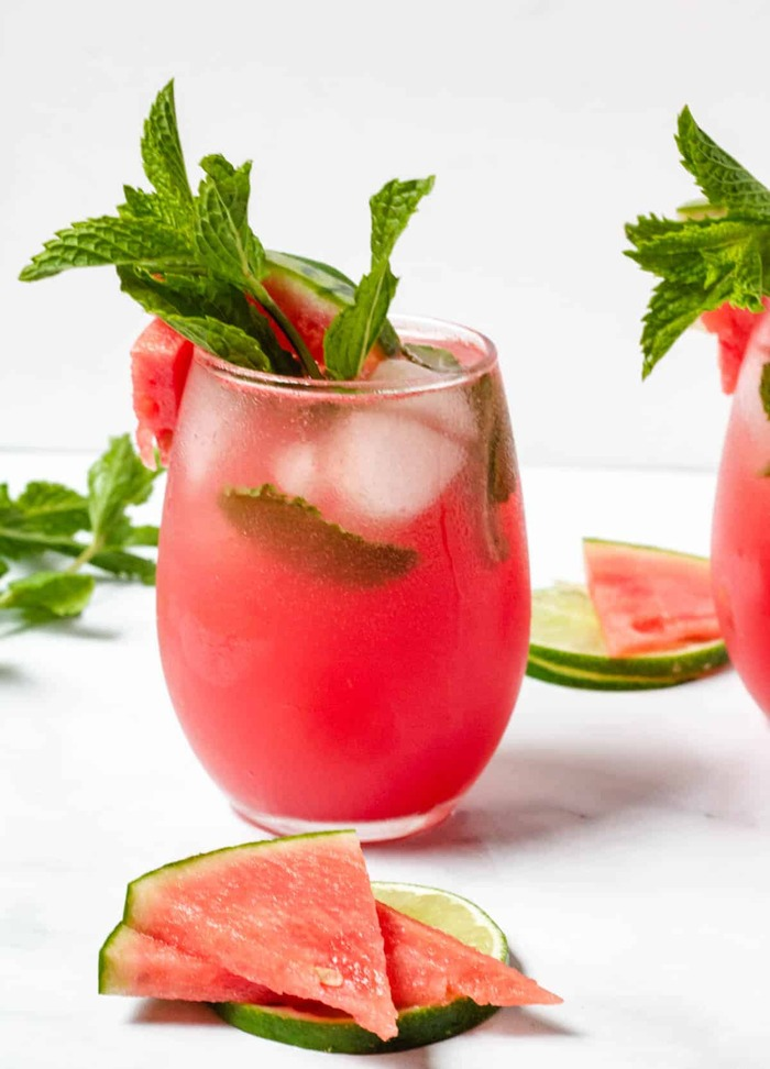watermelon cocktail glass with slices of watermelon and peppermint leaves