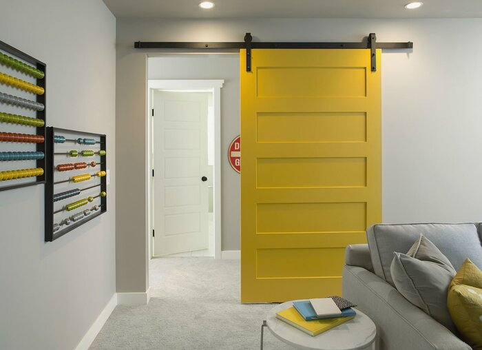 bright yellow accent sliding door in a modern living space with light furniture