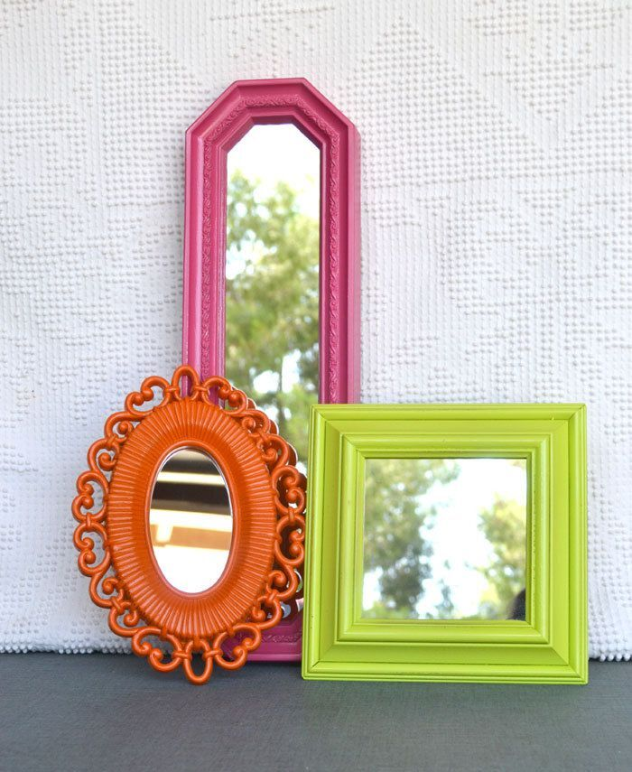 three colorful mirrors in different sizes on a white wall summer decor pieces