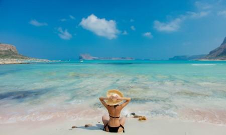 girl in black bikini and with hat on Balos beach