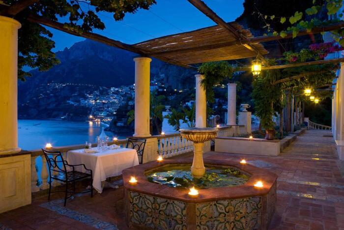 Villa Treville Positano Italy at night with lanterns on open terrace overlooking the amalfi coast