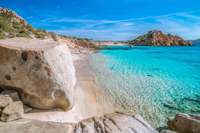 Sardegna island in Italy clear water and white sand rocks on the beach