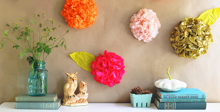 summer flowers colorful wall decor in a home interior books and a blue vase
