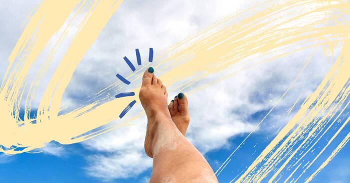sun protection two legs in the air with blue nail polish fun yellow swipe